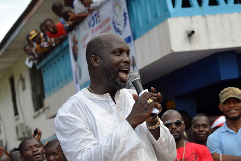 Liberian politician and ex-footballer George Weah speaks during a meeting in Monrovia on November 20, 2014 before the opening of political campaign activities for senatorial elections