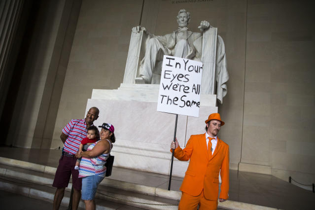 <p>Zach Vance, from Utah County, Utah, poses for a photo in front of the Lincoln Memorial, before the start of the Juggalo March, Sept. 16, 2017 in Washington. (Photo: Al Drago/Getty Images) </p>
