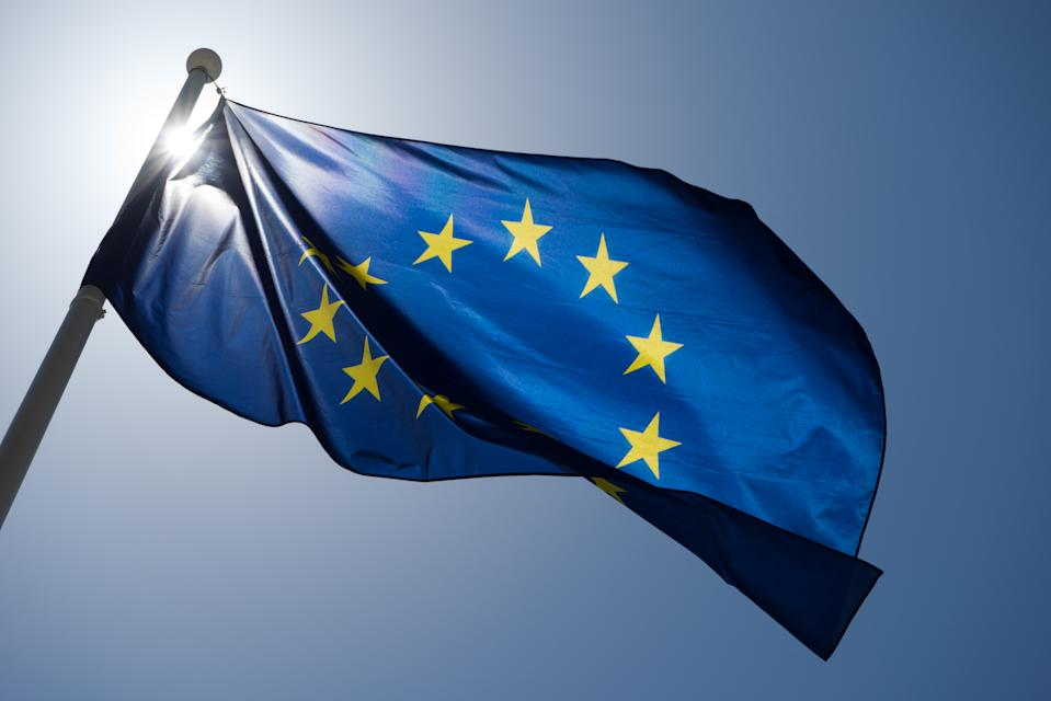 Series of images to create a giff of the EU flag blowing in the wind and contorting with strong backlight