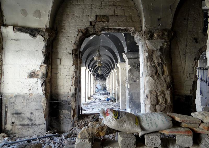 This citizen journalism image taken on Saturday, April 13, 2013, and provided by Aleppo Media Center AMC, which has been authenticated based on its contents and other AP reporting, shows a damaged area of the Aleppo Grand mosque after a battle between the rebels and Syrian government forces, in Aleppo, Syria. Syrian activists say government warplanes have carried out airstrikes around the country. (AP Photo/Aleppo Media Center, AMC)
