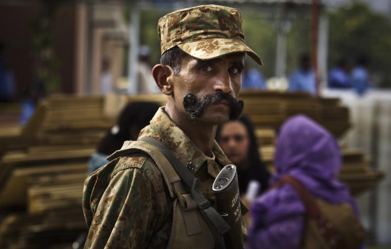 A Pakistani army soldier, guards election material provided to polling agents for tomorrow's elections, in Islamabad, Pakistan, Friday, May 10, 2013. An especially violent spate of killings, kidnappings and bombings marred the run-up to Pakistan's nationwide election, capped Thursday by the abduction of the son of a former prime minister as he was rallying supporters on the last day of campaigning before the historic vote. (AP Photo/B.K. Bangash)