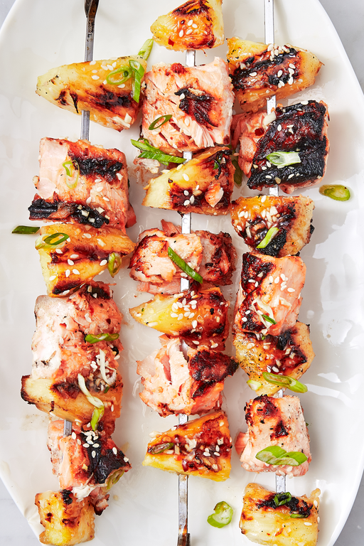 """<p><a href=""""https://www.delish.com/uk/cooking/recipes/a29771277/pineapple-salmon-sheet-pan-dinner-recipe/"""" rel=""""nofollow noopener"""" target=""""_blank"""" data-ylk=""""slk:Pineapple and salmon"""" class=""""link rapid-noclick-resp"""">Pineapple and salmon</a> are a match made in heaven. Smoky, sweet, and just a little spicy, these skewers are a major crowd-pleaser. Make them for your next barbecue, and watch them disappear.</p><p>Get the <a href=""""https://www.delish.com/uk/cooking/recipes/a32399432/pineapple-salmon-skewers-recipe/"""" rel=""""nofollow noopener"""" target=""""_blank"""" data-ylk=""""slk:Pineapple Salmon Skewers"""" class=""""link rapid-noclick-resp"""">Pineapple Salmon Skewers</a> recipe.</p>"""