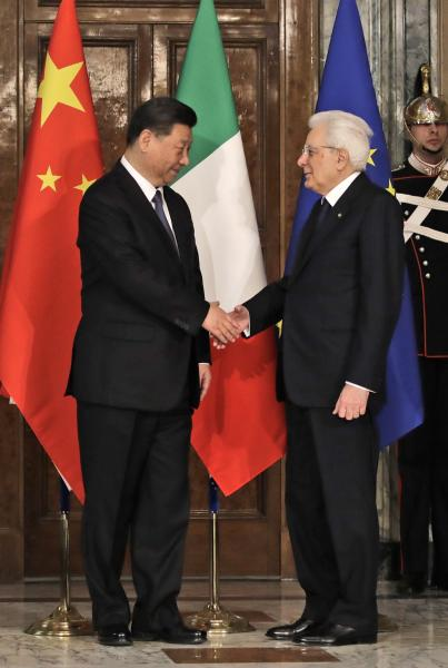 """Chinese President Xi Jinping, left, shakes hands with Italian President Sergio Mattarella at the Quirinale Presidential Palace, in Rome, Friday, March 22, 2019. Jinping is launching a two-day official visit aimed at deepening economic and cultural ties with Italy through an ambitious infrastructure building program called """"Belt and Road"""" that has raised suspicions among Italy's U.S. and European allies. (AP Photo/Alessandra Tarantino, Pool)"""