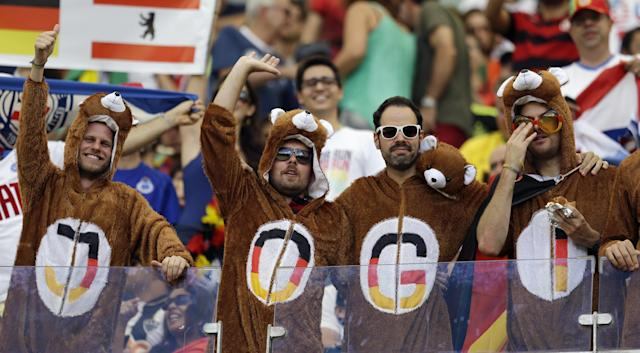German fans wear bear outfits in the stands before the group G World Cup soccer match between Germany and Portugal at the Arena Fonte Nova in Salvador, Brazil, Monday, June 16, 2014. (AP Photo/Natacha Pisarenko)