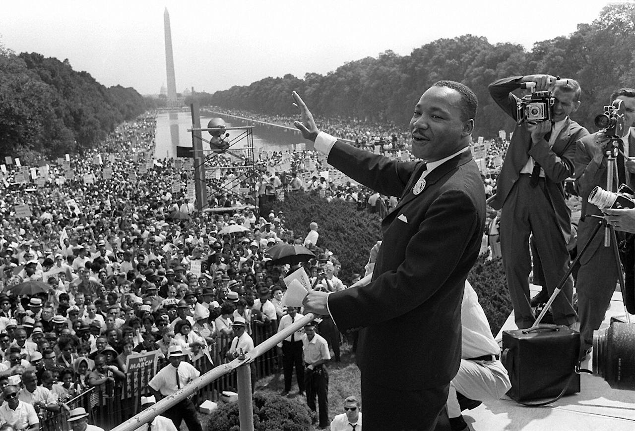 """<p>Dr. Martin Luther King Jr. acknowledges the crowd at the Lincoln Memorial for his """"I Have a Dream"""" speech during the March on Washington, Aug. 28, 1963. (Photo: AFP/Getty Images) </p>"""