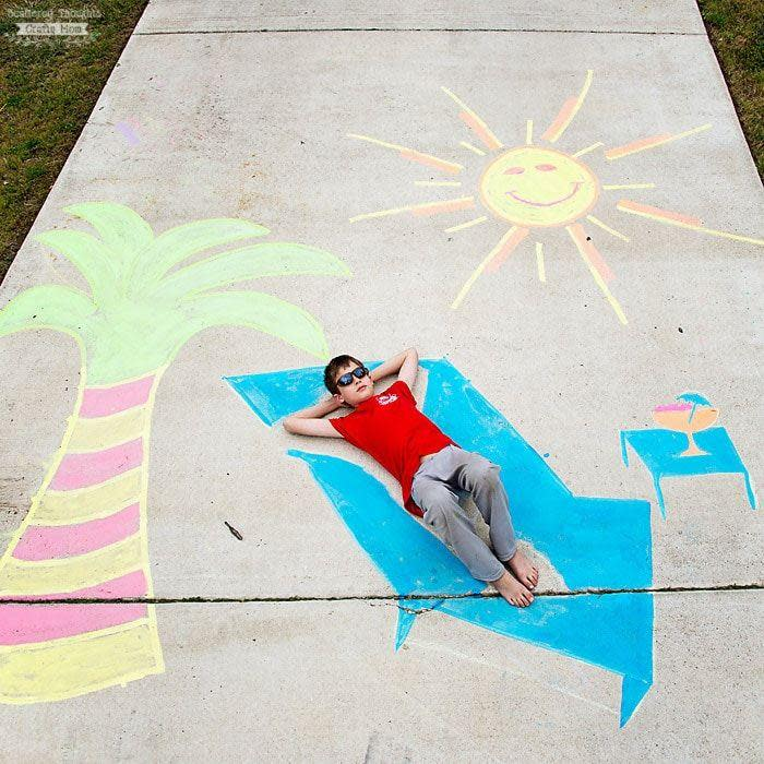 """<p>Chalk your way to a sunny day — no matter the weather outside. Create a sunshiny and transporting scene with a palm tree, chaise lounge, fruity drink on a side table, and of course a smiling sun.</p><p><em><a href=""""https://www.scatteredthoughtsofacraftymom.com/get-creative-10-fun-sidewalk-chalk-ideas/"""" rel=""""nofollow noopener"""" target=""""_blank"""" data-ylk=""""slk:Get the tutorial from Scattered Thoughts of a Craft Mom »"""" class=""""link rapid-noclick-resp"""">Get the tutorial from Scattered Thoughts of a Craft Mom »</a></em></p>"""