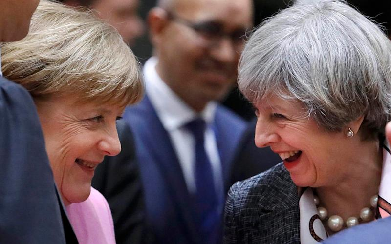British Prime Minister Theresa May and German Chancellor Angela Merkel attend the EU summit in Brussels, Belgium, March 9, 2017.  - YVES HERMAN