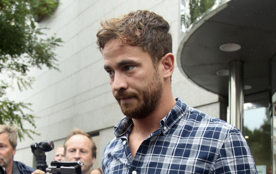 British rugby player Danny Cipriani leaves Jersey Magistrates' Court, Saint Helier, Jersey, one of the Channel Islands, on Thursday Aug. 16, 2018, where he pleaded guilty to charges of common assault and resisting arrest following an incident in a nightclub on the island. (Yui Mok/PA via AP)