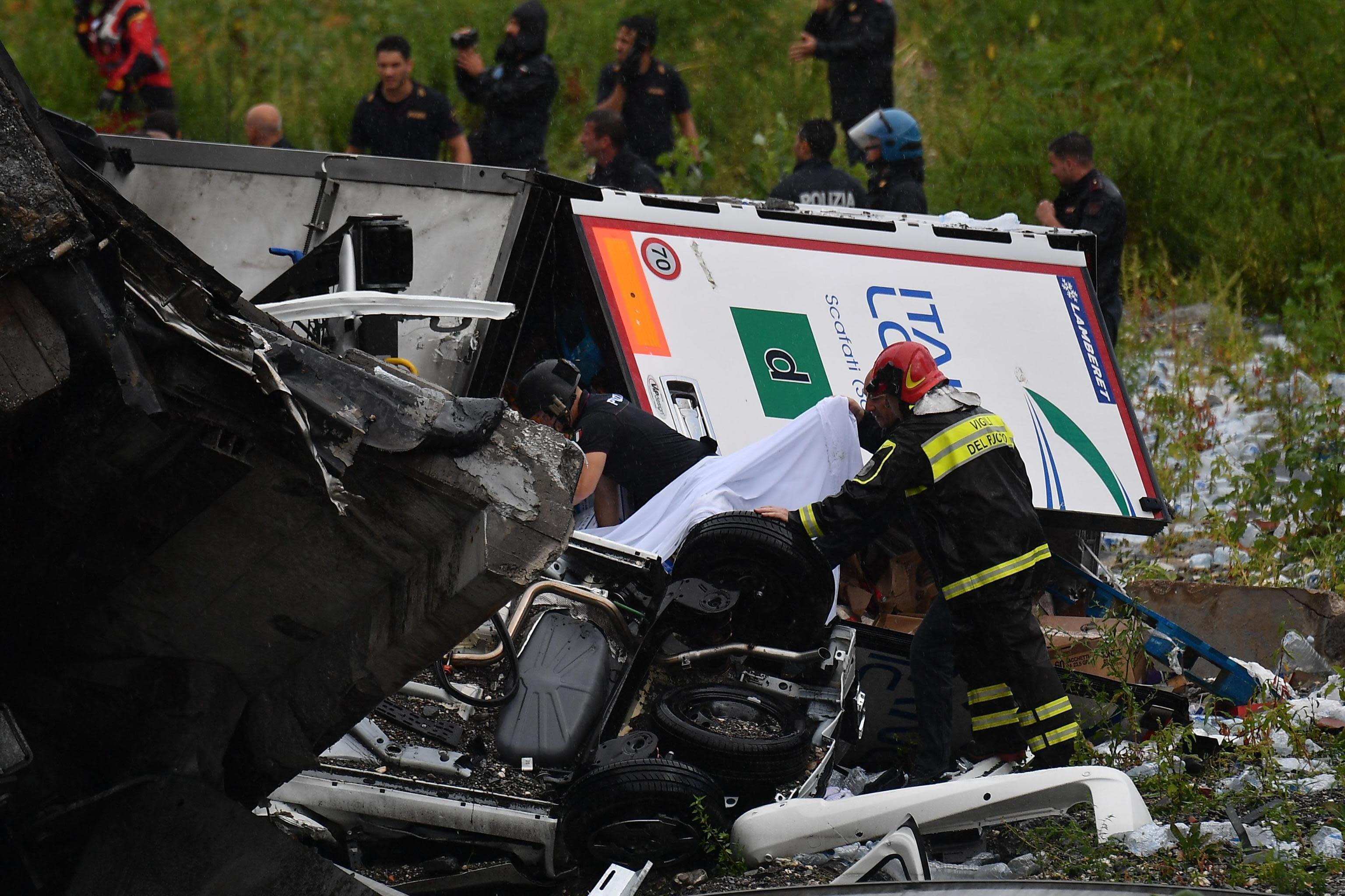 Carnage: At least ten vehicles were said to have been involved in the collapse. (PA)