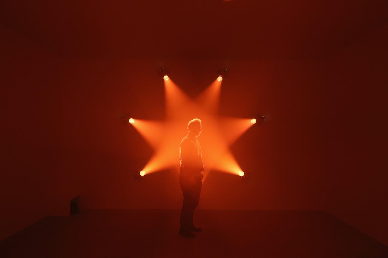 LONDON, ENGLAND - JANUARY 29:  A man admires an art installation by Ann Veronica Janssens entitled 'Rose' which features in the Hayward Gallery's exhibition 'Light Show' on January 29, 2013 in London, England. 'Light Show' features 25 illuminated installations and sculptures by major international artists from the 1960s to the present day. The show opens to the general public on January 30, 2013 and runs until April 28, 2013.  (Photo by Oli Scarff/Getty Images)