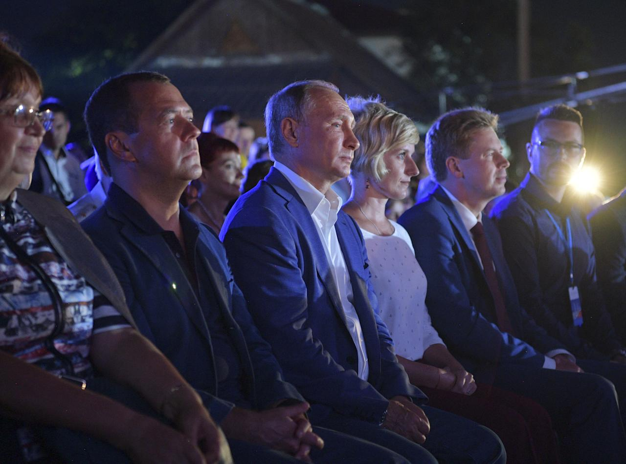 "Russia's President Vladimir Putin (third from the left) and Prime Minister Dmitry Medvedev (second from the left) attend the musical festival ""Opera in Chersonese"" in the Black Sea port of Sevastopol, Crimea, August 18."