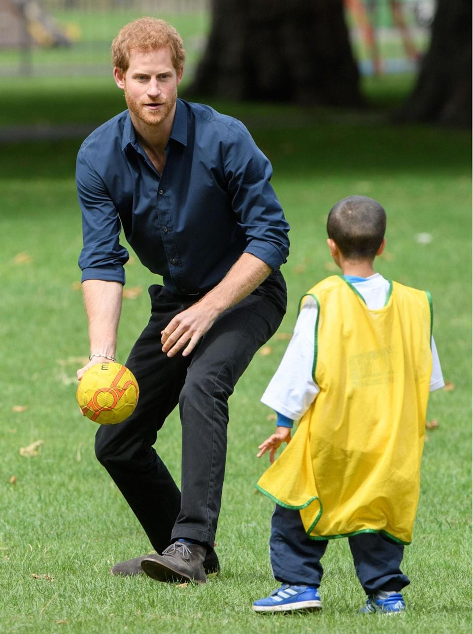 <p><span>Prince Harry plays with a young boy at StreetGames' Fit and Fed initiative in Newham, London. (Rex features)</span> </p>