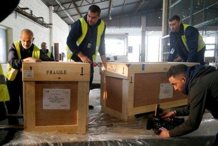 Workers unload boxes of artefacts at Beirut's International Airport, in Beirut, Lebanon January 12, 2018. REUTERS/Mohamed Azakir