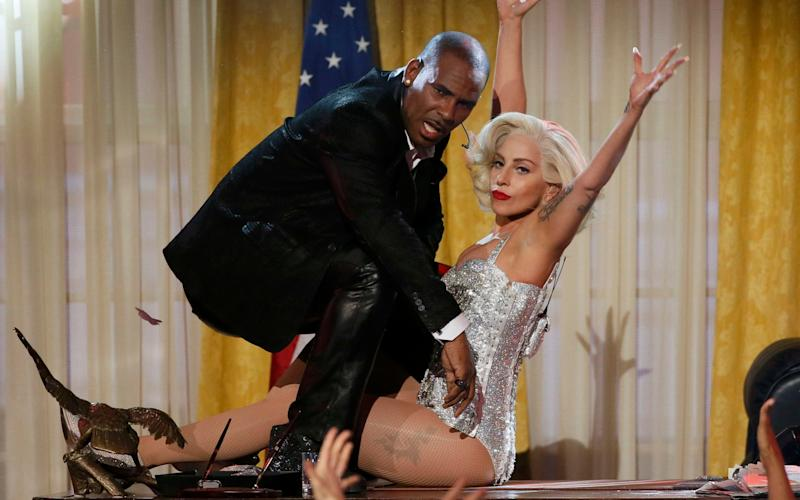 R. Kelly and Lady Gaga performing at the American Music Awards in Los Angeles in 2013