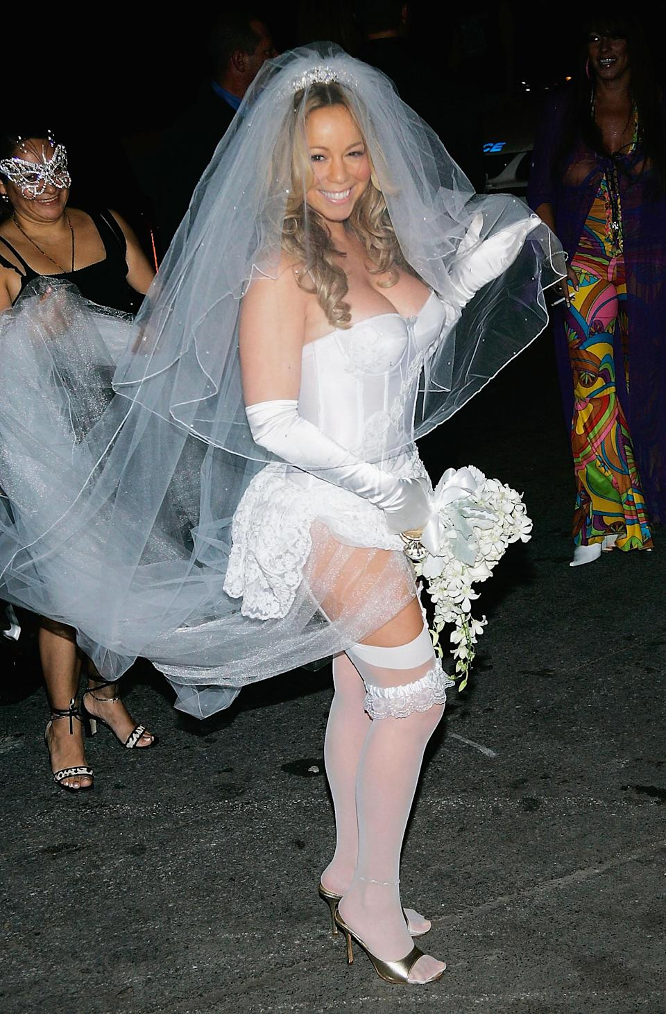 Pictured here is Mariah Carey at a Halloween party in 2004 wearing a costume that might be a little bit basic, sure, but not if you're the elusive chanteuse. Dressing as a bride is common because it's so fun and easy, and you can go as traditional or sexy as you'd like.