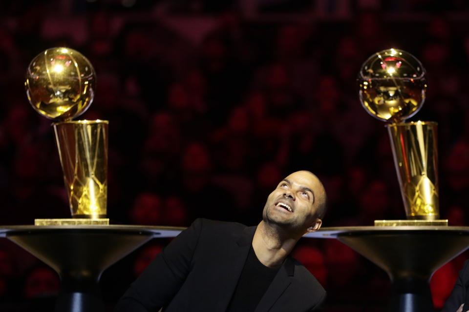 Former San Antonio Spurs guard Tony Parker looks up during his retirement ceremony after the team's NBA basketball game against the Memphis Grizzlies in San Antonio, Monday, Nov. 11, 2019. (AP Photo/Eric Gay)