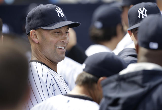 New York Yankees shortstop Derek Jeter laughs with teammates in the dugout during an exhibition baseball game against the Pittsburgh Pirates Thursday, Feb. 27, 2014, in Tampa, Fla. (AP Photo/Charlie Neibergall)