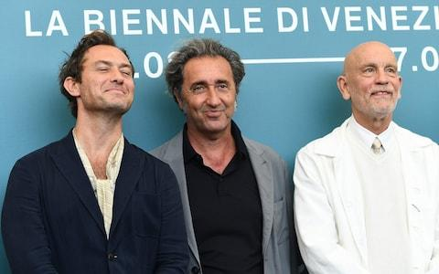 Jude Law, Paolo Sorrentino and John Malkovich at the Venice Film Festival - Credit: AFP