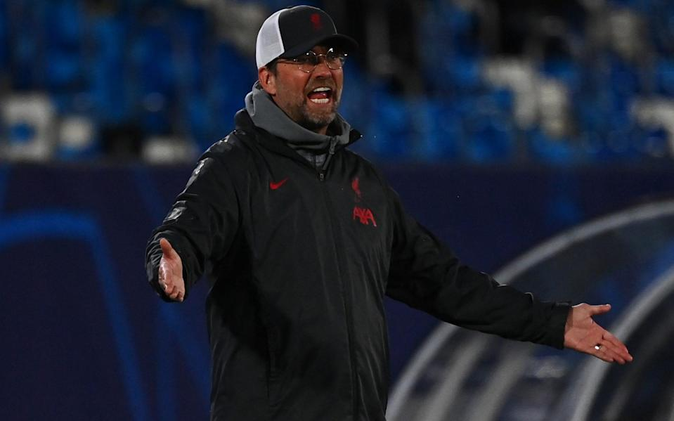 Liverpool's German manager Jurgen Klopp reacts during the UEFA Champions League first leg quarter-final football match between Real Madrid and Liverpool at the Alfredo di Stefano stadium in Valdebebas - GABRIEL BOUYS / AFP