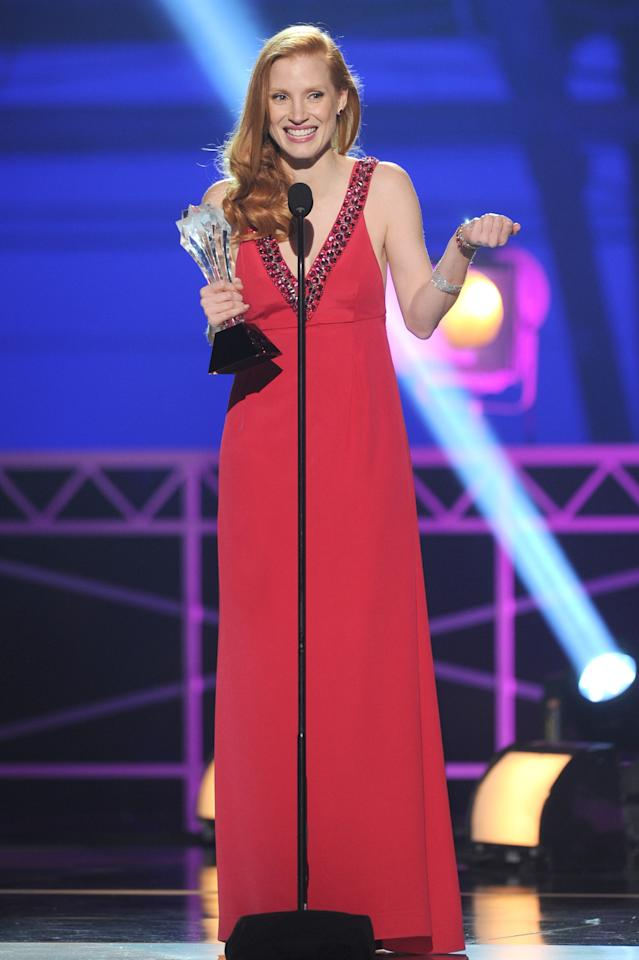 "SANTA MONICA, CA - JANUARY 10:  Actress Jessica Chastain accepts the Best Actress Award for ""Zero Dark Thirty"" onstage at the 18th Annual Critics' Choice Movie Awards held at Barker Hangar on January 10, 2013 in Santa Monica, California.  (Photo by Kevin Winter/Getty Images)"