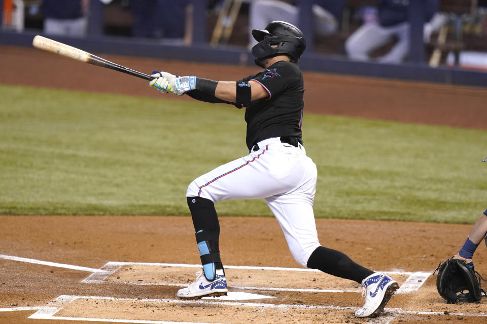 Miami Marlins' Miguel Rojas hits a solo home run during the first inning of a baseball game against the Milwaukee Brewers, Saturday, May 8, 2021, in Miami. (AP Photo/Lynne Sladky)