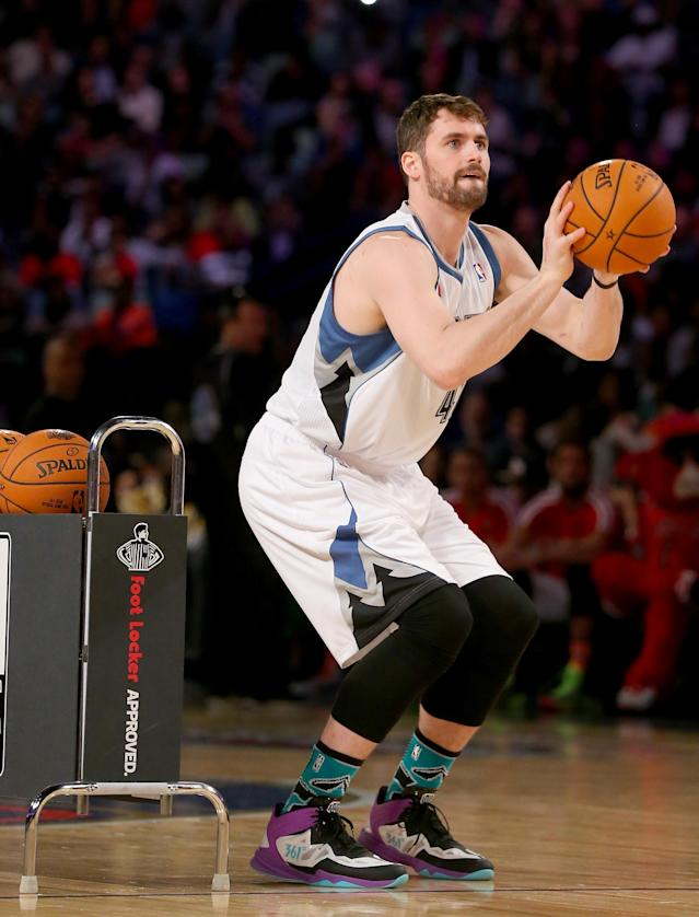 Kevin Love of the Minnesota Timberwolves competes during the Foot Locker Three-Point Contest 2014 on February 15, 2014 in New Orleans, Louisiana (AFP Photo/Ronald Martinez)