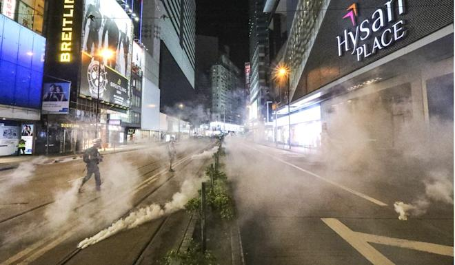 Riot police fire tear gas in Causeway Bay during confrontations with protesters. Photo: Felix Wong