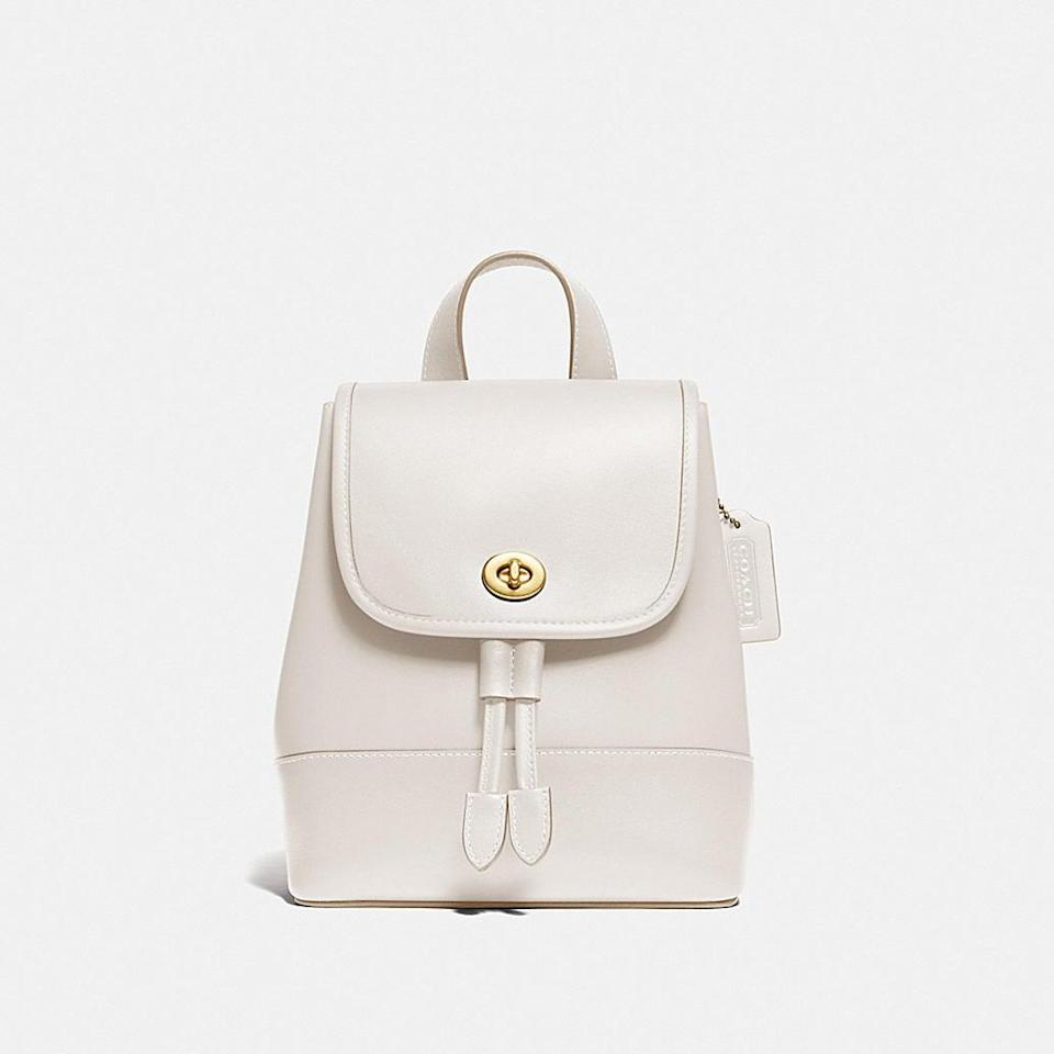 <p>Trade in your heavy tote for this <span>Coach Turnlock Backpack</span> ($350).</p>