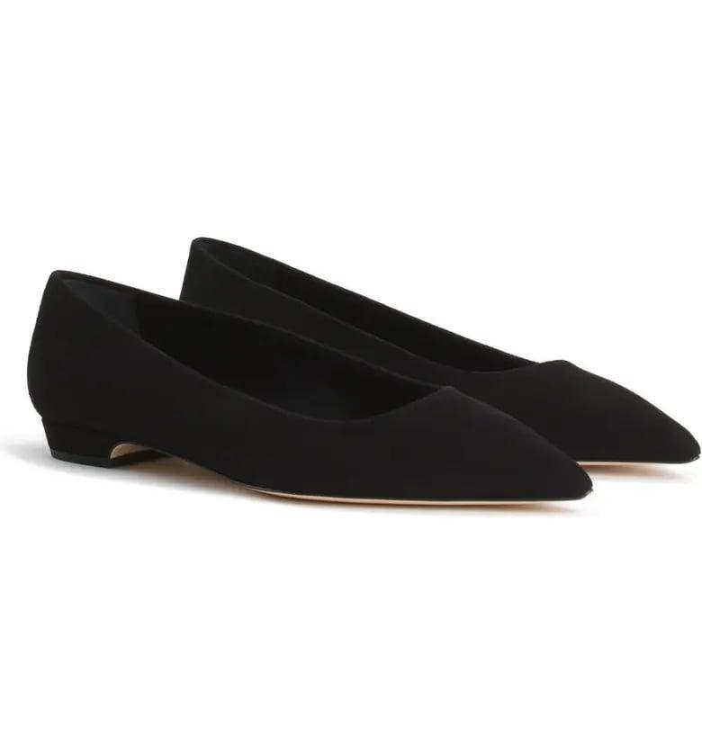 <p>As far as we're concerned, everyone should have a pair of simple black flats in their closet. Decked out with a subtle heel, <span>Good American's The Statement Flats</span> ($139) are a grown-up alternative to those ballerina flats you wore 24/7 in high school.</p>