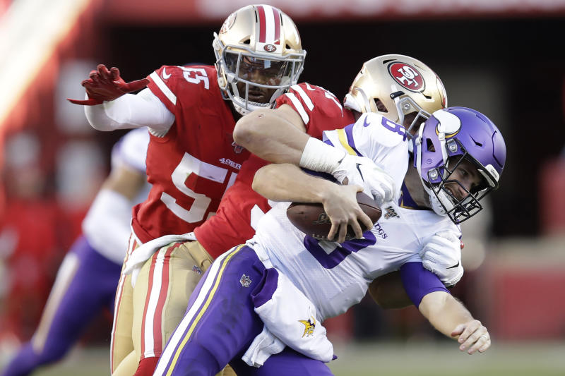 Minnesota Vikings quarterback Kirk Cousins, foreground, is tackled by San Francisco 49ers defensive end Nick Bosa, center, during the second half of an NFL divisional playoff football game, Saturday, Jan. 11, 2020, in Santa Clara, Calif. Also pictured at rear is defensive end Dee Ford. (AP Photo/Ben Margot)