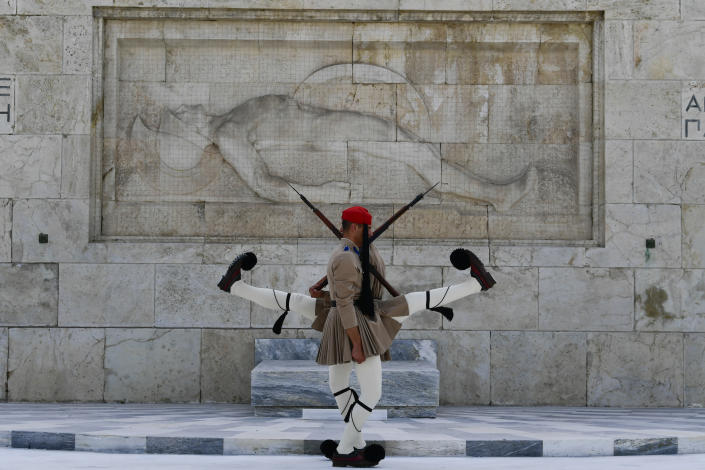 Evzones of the Greek Presidential Guard in front of the Tomb of the Unknown Soldier in Athens Greece, Tuesday, Aug. 3, 2021. Authorities in Greece have closed the Acropolis and other ancient sites during afternoon hours as a heatwave scorching the eastern Mediterranean continued to worsen. Temperatures reached 42 C (107.6 F) in parts of the Greek capital, as the extreme weather fueled deadly wildfires in Turkey and blazes across the region. (AP Photo/Michael Varaklas)