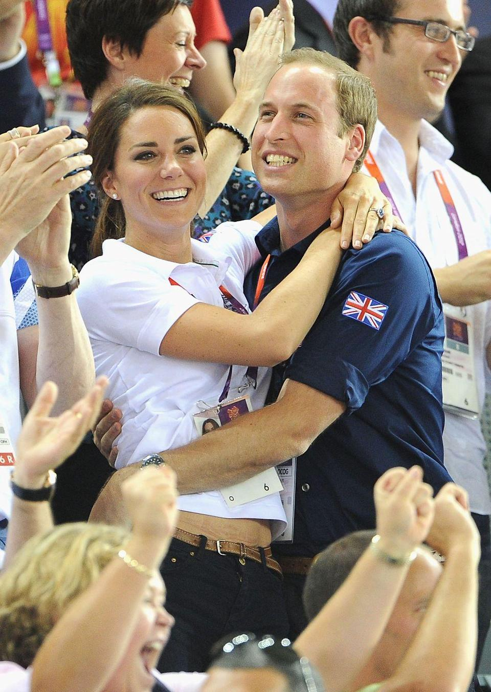 <p>Kate and Will embrace, celebrating a British cyclist's gold medal win at the London Olympics.<br></p>