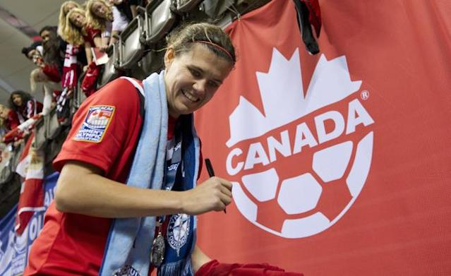 VANCOUVER, CANADA - JANUARY 29: Christine Sinclair #12 of Canada signs autographs for fans after the championship game of the 2012 CONCACAF Women's Olympic Qualifying Tournament against the United Sates at BC Place on January 29, 2012 in Vancouver, British Columbia, Canada. (Photo by Rich Lam/Getty Images)