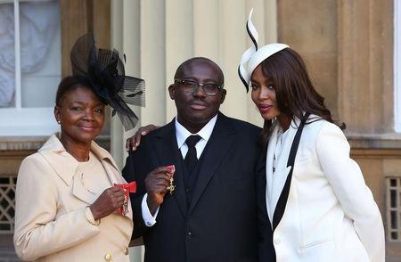 Model Naomi Campbell (R) poses for a photograph with Baroness Amos (L) and fashion stylist Edward Enninful, after Amos received her Member of the Order of the Companions of Honour, and Enninful his Officer of the Order of the British Empire (OBE), at Buckingham Palace in London, Britain October 27, 2016.  REUTERS/Philip Toscano/Pool