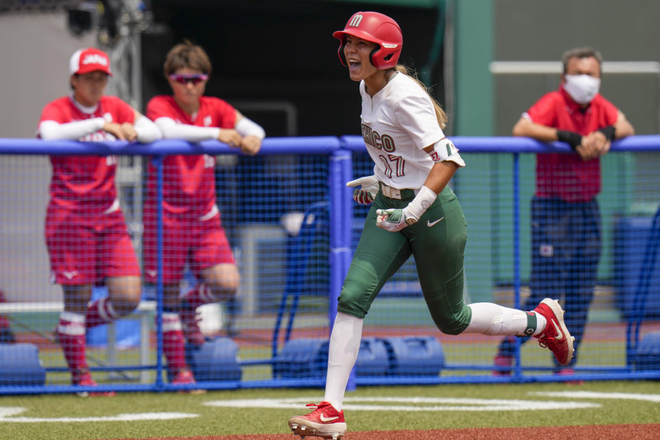 Mexico's Anissa Urtez celebrates as she completes a home run during the softball game between the Mexico and Japan at the 2020 Summer Olympics, Thursday, July 22, 2021, in Fukushima , Japan. (AP Photo/Jae C. Hong)