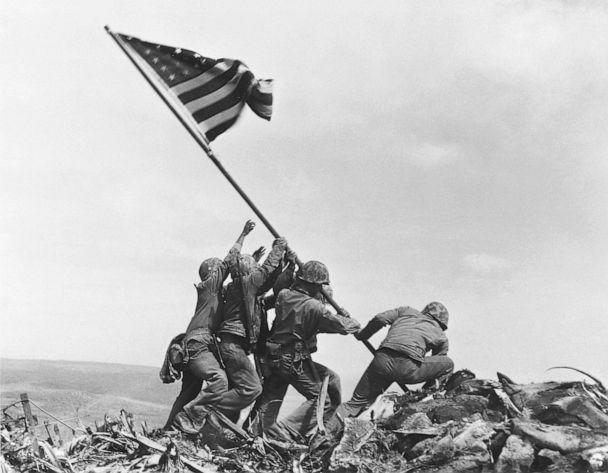 PHOTO: U.S. Marines of the 28th Regiment, 5th Division, raise the American flag atop Mt. Suribachi, Iwo Jima on Feb. 23, 1945. The iconic Pulitzer Prize-winning photo was taken five days after the Marines landed on the island. (Joe Rosenthal/AP)