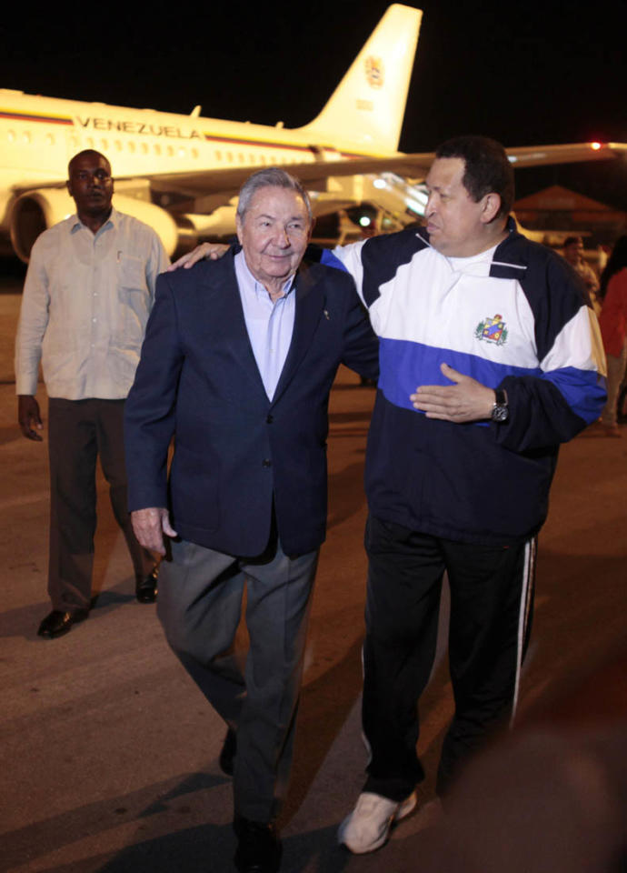 Venezuelan President Hugo Chavez (R) is welcomed by Cuban President Raul Castro at Jose Marti airport in Havana May 1, 2012. The 57-year-old socialist leader has been shuttling between Caracas and Havana for treatment on an unspecified cancer that is hampering his ability to campaign for an October 7 presidential election in the OPEC member nation. REUTERS/Handout/Miraflores Palace