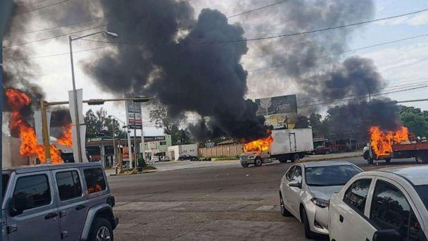 PHOTO: A view of vehicles on fire during a clash between armed gunmen and Federal police and military soldiers, in the streets of the city of Culiacan, Sinaloa state, Mexico, Oct. 17, 2019. (STR/EPA-EFE via Shutterstock, FILE)