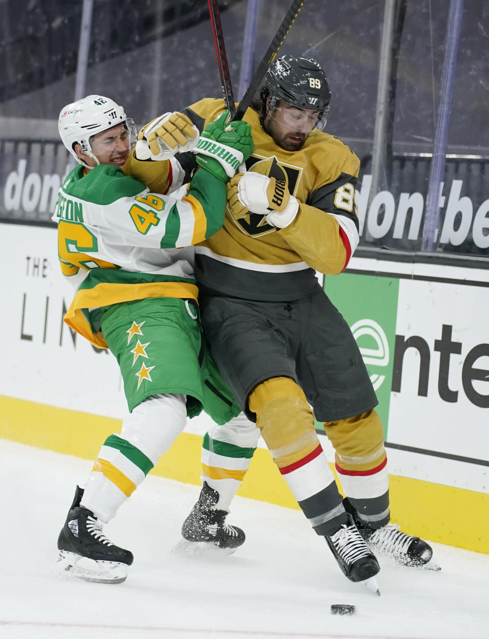 Minnesota Wild defenseman Jared Spurgeon (46) vies for the puck with Vegas Golden Knights right wing Alex Tuch (89) during the second period of an NHL hockey game Wednesday, March 3, 2021, in Las Vegas. (AP Photo/John Locher)