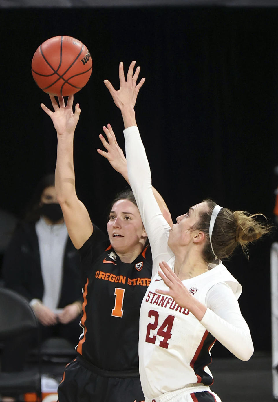 Oregon State guard Aleah Goodman (1) shoots as Stanford guard Lacie Hull (24) defends during the second half of an NCAA college basketball game in the semifinal round of the Pac-12 women's tournament Friday, March 5, 2021, in Las Vegas. (AP Photo/Isaac Brekken)