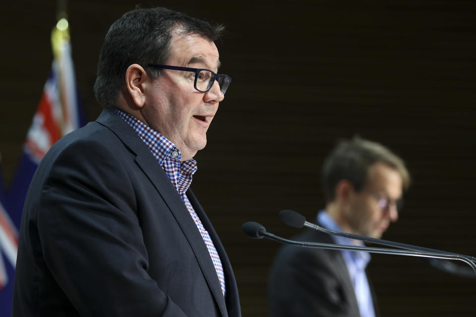 New Zealand's Deputy Prime Minister Grant Robertson speaks to media during a news conference at Parliament in Wellington, New Zealand, Sunday, Sept. 5, 2021. New details emerged Sunday about how an extremist inspired by the Islamic State group was able to remain in New Zealand despite his fraudulent refugee application and alarming behavior. (Hagen Hopkins/Pool Photo via AP)