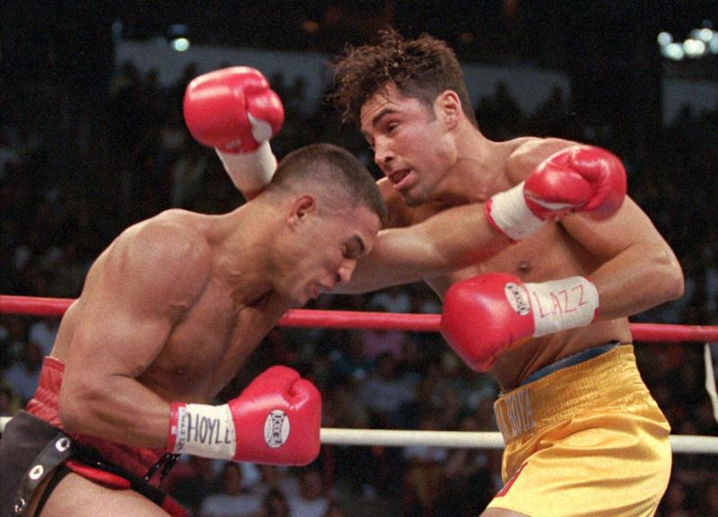 FILE - This Sept. 13, 1997 file photo shows Hector Camacho, left, of Puerto Rico, and Oscar De La Hoya of Los Angeles exchanging blows in the first round of their WBC welterweight championship in Las Vegas. Police in the Puerto Rican city of Bayamon say they found drugs inside the car in which former champion boxer Camacho was shot and critically wounded. Camacho was in critical condition Wednesday, Nov. 21, 2012, at the Centro Medico trauma center in San Juan. (AP Photo/Mike Salsbury, File)