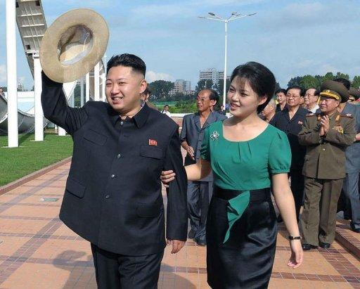 """North Korean leader Kim Jong-Un (L), accompanied by his wife Ri Sol-Ju (R), visit the Rungna People's Pleasure Ground in Pyongyang. While Kim Jong-Il's wives were never pictured at official functions, """"the regime is now facing a different situation, and the move is part of work to make Kim Jong-Un appear old and wise enough to rule"""", said Seoul-based online newspaper the Daily NK"""