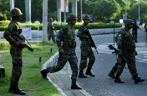 Indian city under siege after clashes over 'rape guru' kill 36