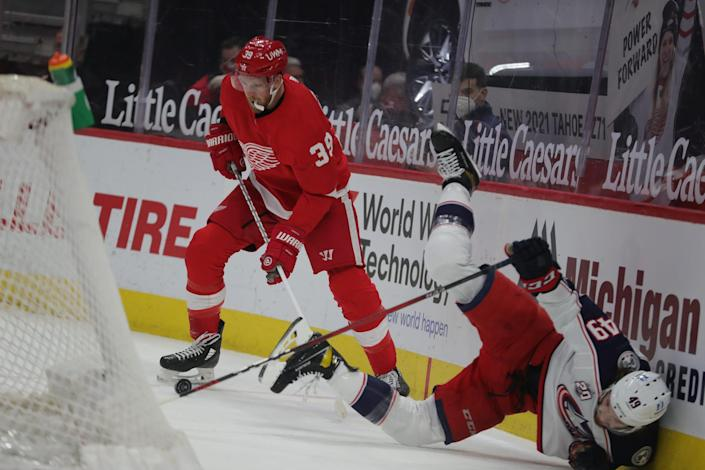 Detroit Red Wings right wing Anthony Mantha (39) defends against Columbus Blue Jackets center Ryan MacInnis (49) during first period action Sunday, March 28, 2021 at Little Caesars Arena in Detroit.