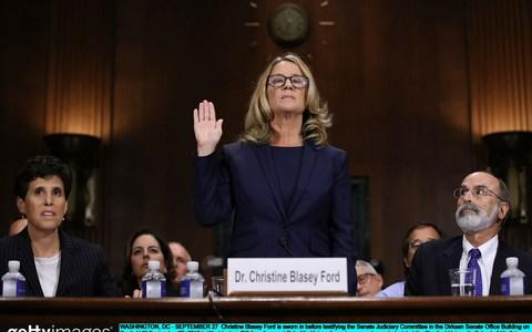 Christine Blasey Ford being sworn in before testifying the Senate Judiciary Committee in September - Credit: Win McNamee/Getty Images