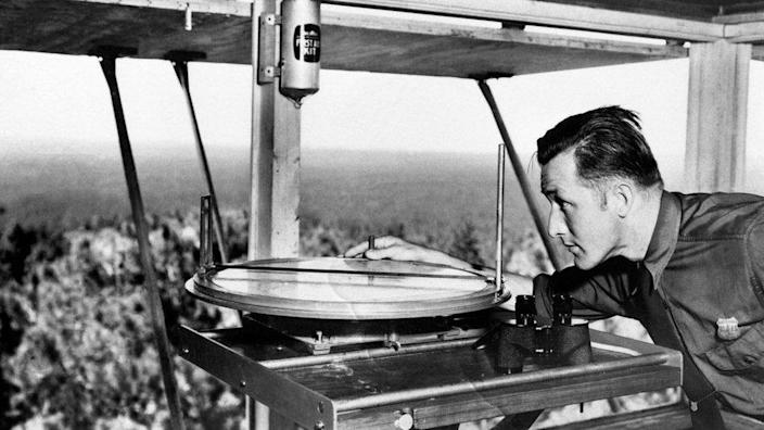 A lookout using an Osborne Fire Finder at a tower overlooking Coconino Nation Forest in 1941