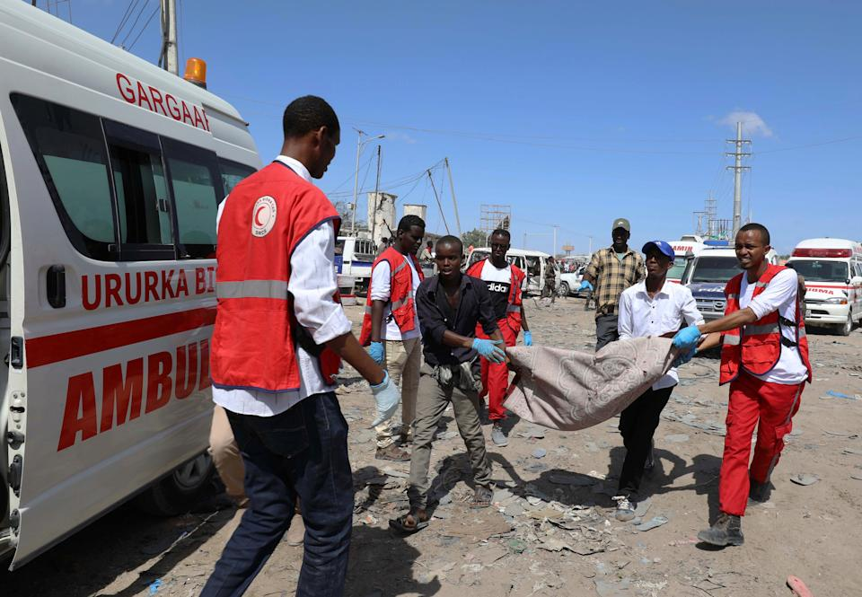 SENSITIVE MATERIAL. THIS IMAGE MAY OFFEND OR DISTURB  Civilians carry the dead body of a man killed in a car bomb explosion at a checkpoint in Mogadishu, Somalia  December 28, 2019. REUTERS/Feisal Omar