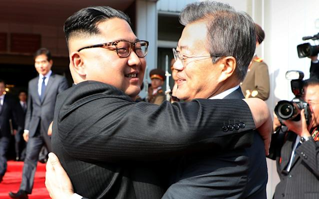 President Moon Jae-in bid farewell to Kim Jong-un with a triple hug after their summit at the truce village of Panmunjom on Saturday - REUTERS