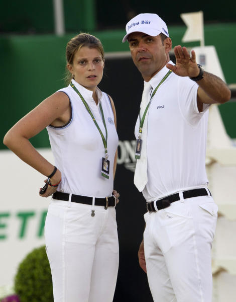 "Granddaughter and sole heiress of the late shipping tycoon Aristotle Onassis, Athina Onassis, left, and her husband, Brazilian professional show jumper Alvaro ""Doda"" de Miranda, speak at the Athina Onassis International Horse Show 2012 in Rio de Janeiro, Brazil, Thursday, Oct. 4, 2012. The show which is considered the largest equestrian event in Latin America brings together the best riders in the world competing in jumping and dressage. (AP Photo/Silvia Izquierdo)"